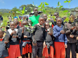 school children with young trees